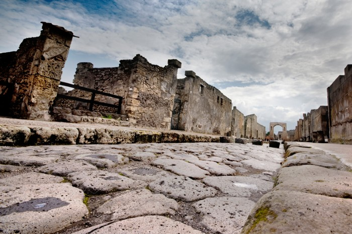 Stone-paved street in Pompeii leading to Roman gateway
