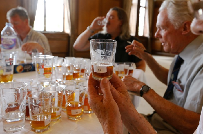 Judges taste beer during a competition at a beer festival