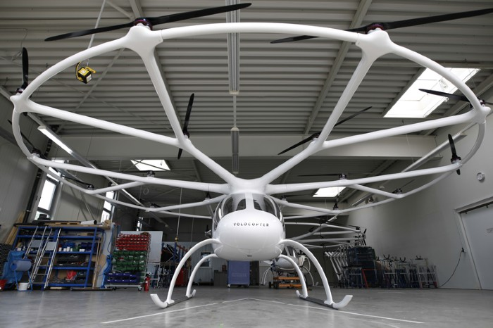 A Volocopter 2X multirotor electric helicopter stands in a hangar at the Volocopter GmbH headquarters in Bruchsal, Germany