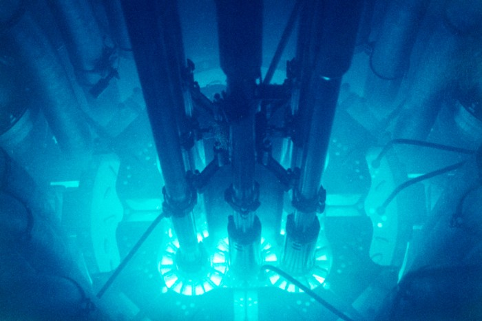Nuclear reactor core glows blue due to Cherenkov radiation