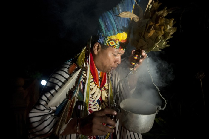 A healer with a hallucinogenic mixture during a traditional ceremony in Colombia