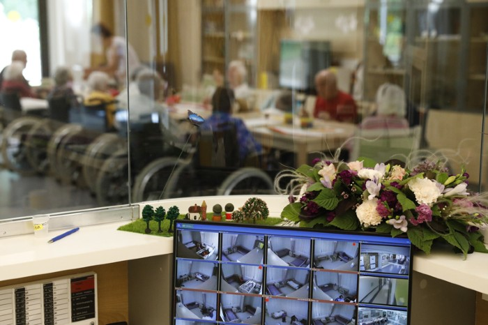 A computer monitor showing surveillance cameras images at a geriatric care centre