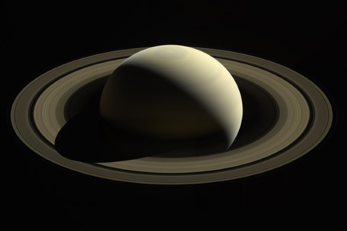 A view captured by Cassini of Saturn casting a shadow across its main rings