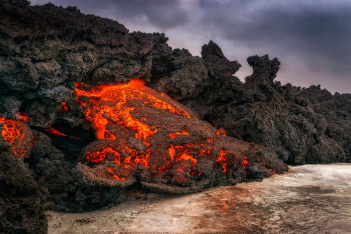 Glowing lava flowing from an eruption of the Bardarbunga Volcano, Iceland