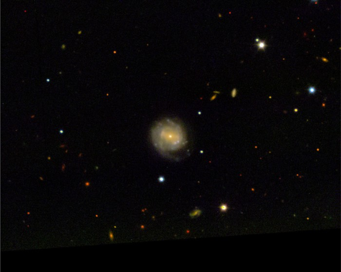 An image of supernova explosion AT2018cow and its host galaxy, CGCG 137-068.