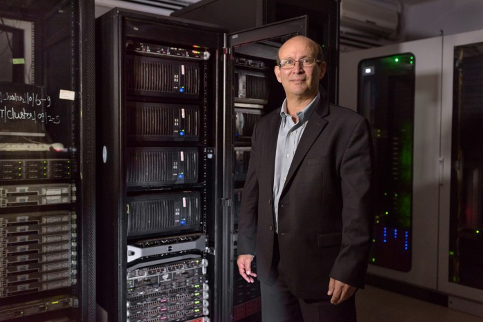 Carl Malamud poses for a portrait in from of data servers at Jawaharlal Nehru University