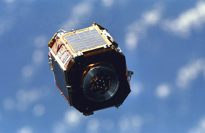 SAC-A satellite in orbit above the Earth.