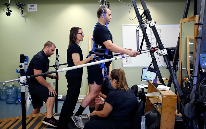 Rob Summers practices treadmill locomotive training at Frazier Rehab Institute in Louisville, Kentucky