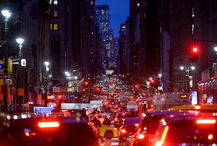 Cars are seen in a traffic jam in their evening commute on the 5th Avenue, New York
