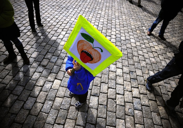 A child holds a sign during a demonstration against genetically modified organisms in Sofia, Bulgaria