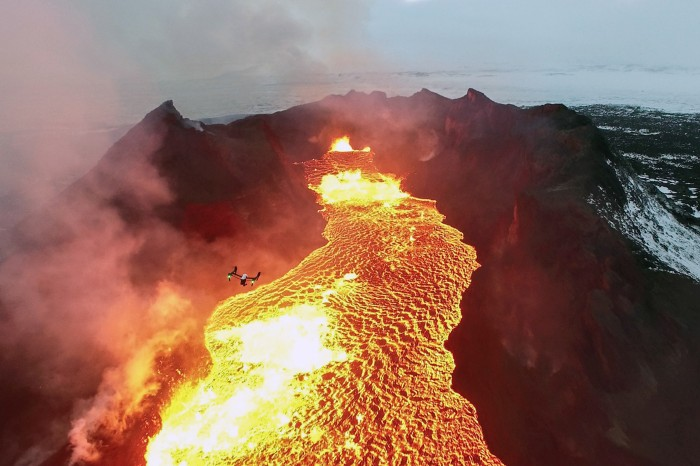 A drone flying over the huge lava lake in Iceland