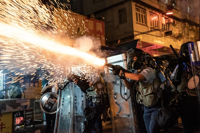 Police fire tear gas to clear pro-Democracy protesters in Hong Kong