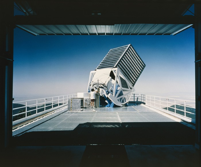 An astronomer works on the main telescope of the Sloan Digital Sky Survey.