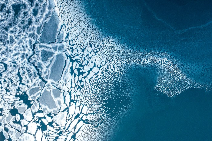 Arctic landscape of ice breaking off into the sea