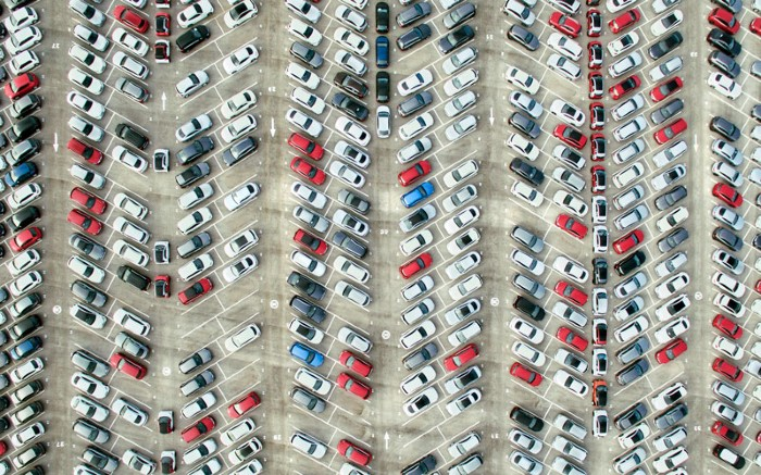 Aerial view of parked cars.