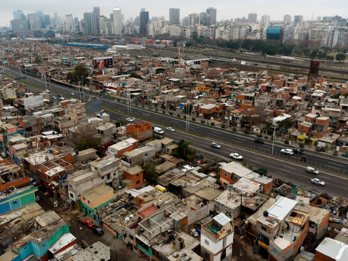 View of the Villa 31 shantytown with the upscale Recoleta neighborhood in the background in Buenos Aires, Argentina.