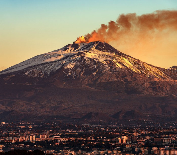 Catania and Mount Etna Volcano in Sicily, Italy.