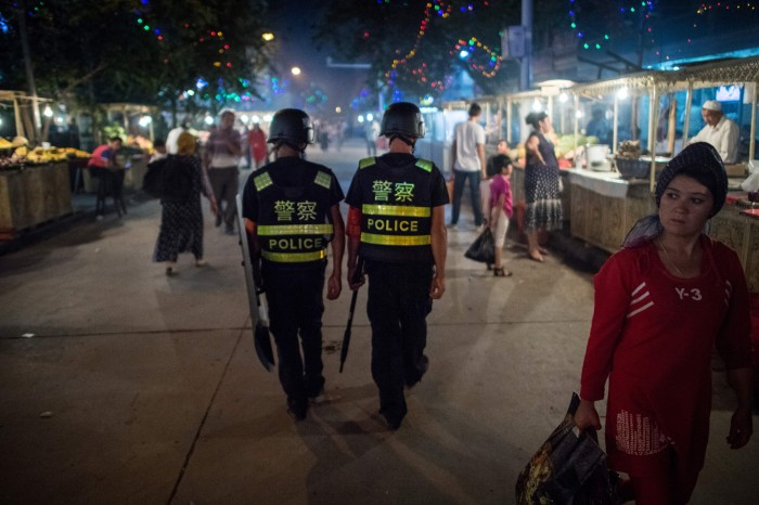 Police patrolling in a night food market near the Id Kah Mosque in Kashgar in China's Xinjiang Uighur Autonomous Region