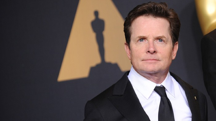 Actor Michael J. Fox poses in the press room at the 89th annual Academy Awards.