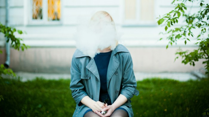 Young Woman Smoking Electronic Cigarette.