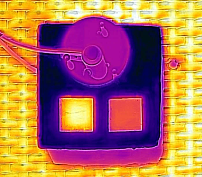 Thermal camera picture of the monolayer and the bilayer. Bilayer (RIGHT) stays cooler under sun exposure.
