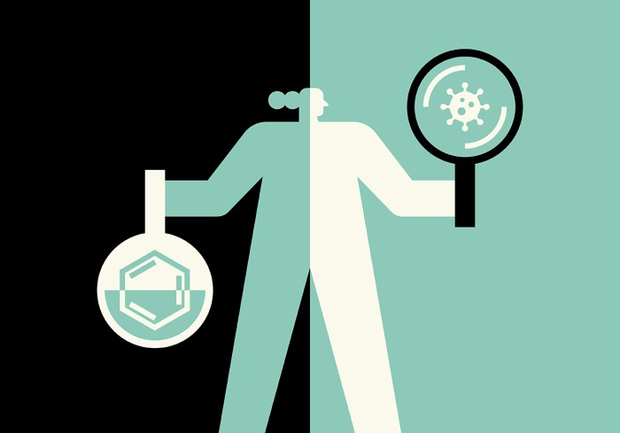 Cartoon of a person holding a flask containing a chemical structure in one hand, the other a magnifying glass looking at a virus