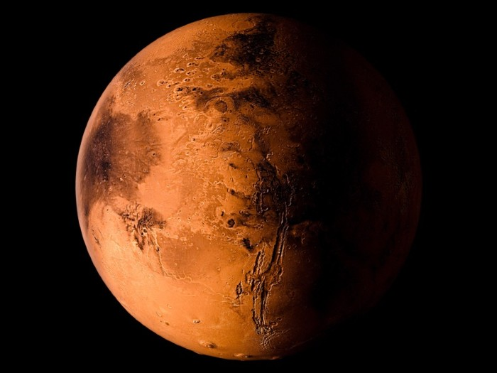 3D rendering of the planet Mars on a black background. Elements of the image furnished by NASA.