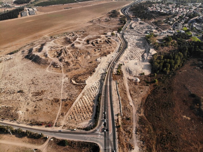 Aerial view of a main road running through an archaeological excavation site in Israel