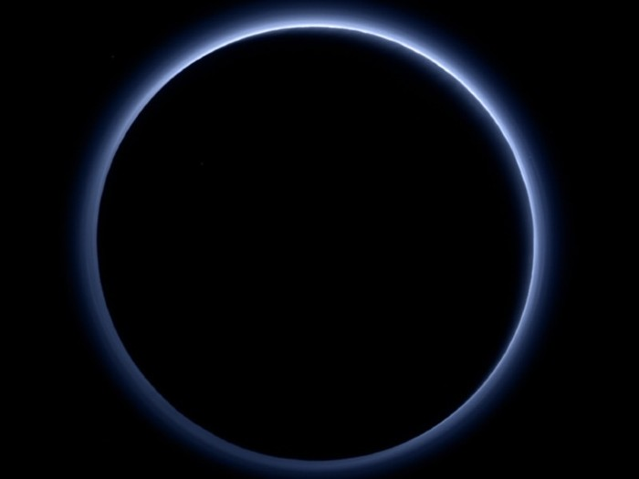 Black disk with thin blue/white glow around it and black background.
