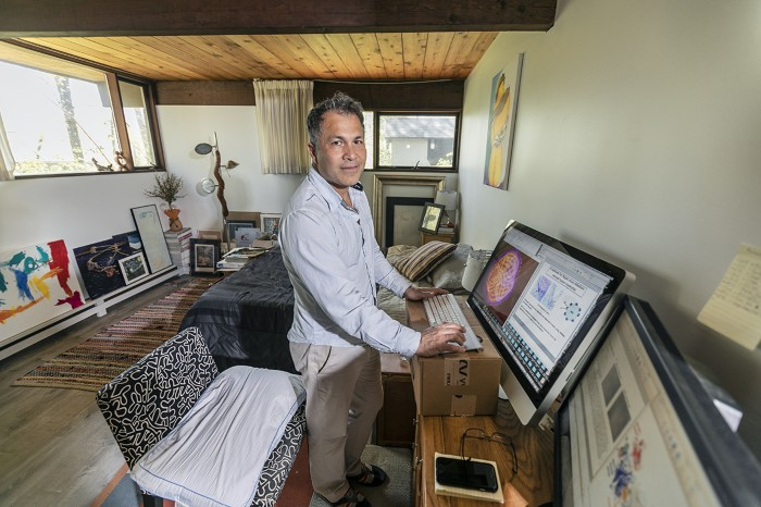 Hector Aguilar-Carreno, an immunologist at Cornell University, working from home during the pandemic