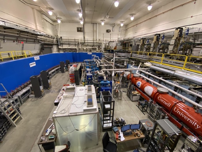 Linear particle accelerator housed in high-ceilinged laboratory.