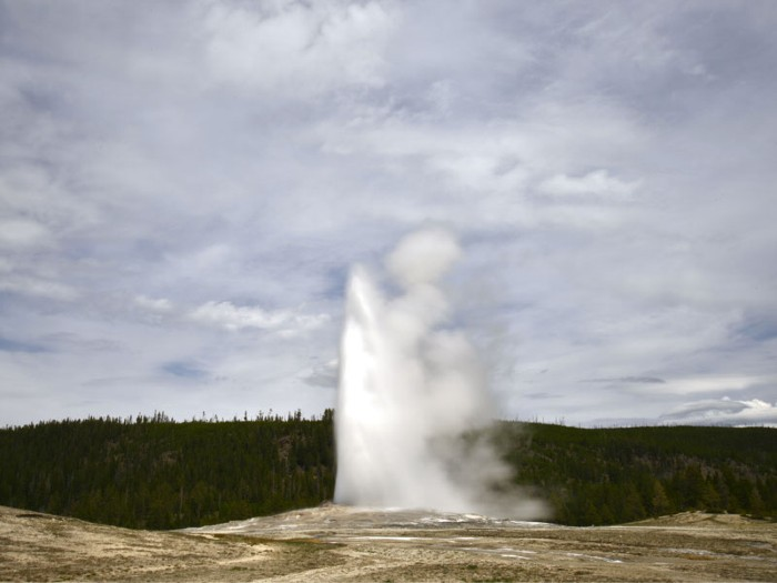 Old Faithful erupts in Upper Geyser Basin.
