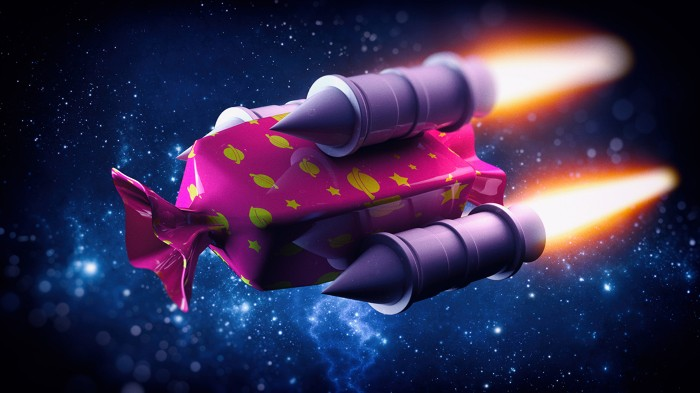A giant sweet in a pink wrapper with jet engines flies through space