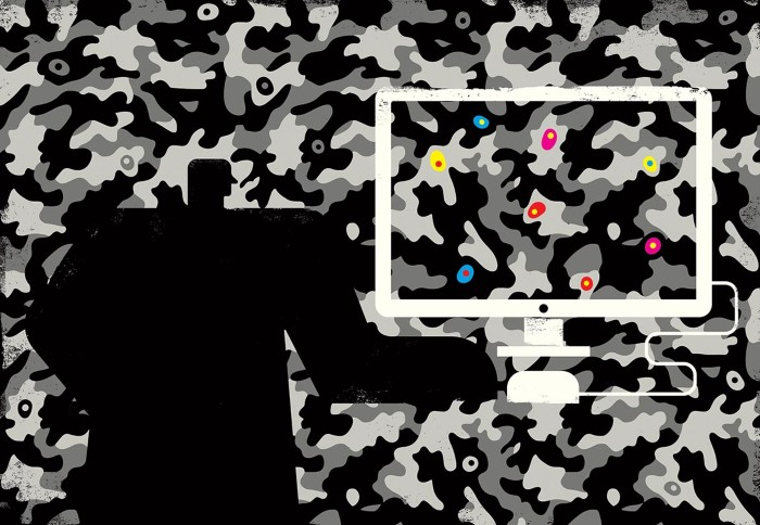 A cartoon human figure uses a computer to pick out cells in colour hidden within a camouflage pattern