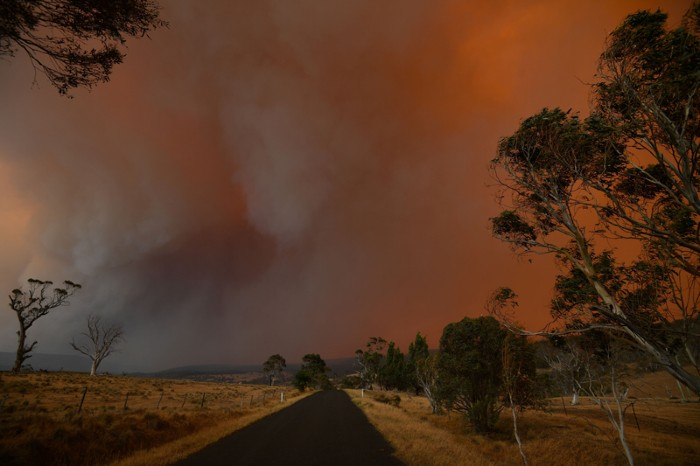Ember and thick smoke from bushfires reach Braemar Bay in New South Wales