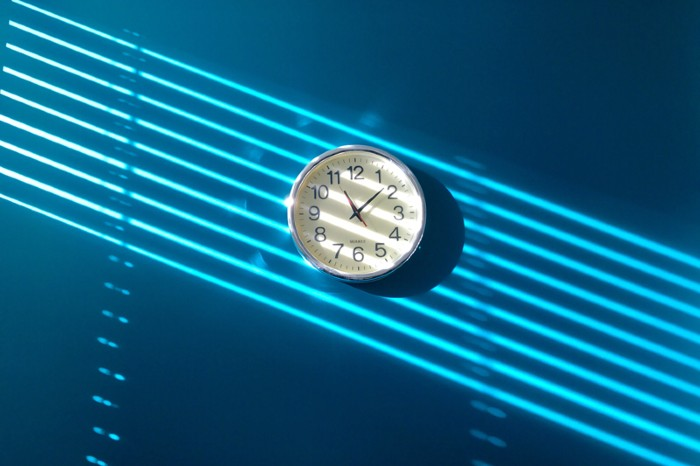 Clock hanging on a blue wall