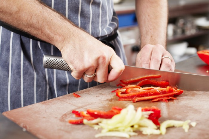 Chef chopping vegetables in a kitchen
