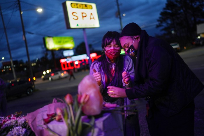Mourners place a candle at a makeshift memorial outside Gold Spa, Georgia, US, where eight people were shot and killed