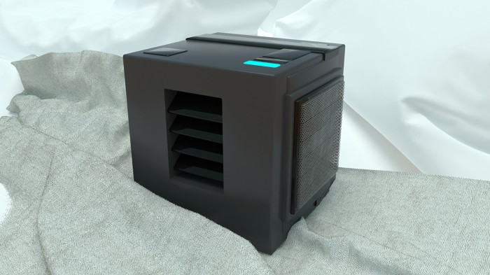 A black cuboid machine with a glowing blue light on its top sits on a crumpled bed sheet
