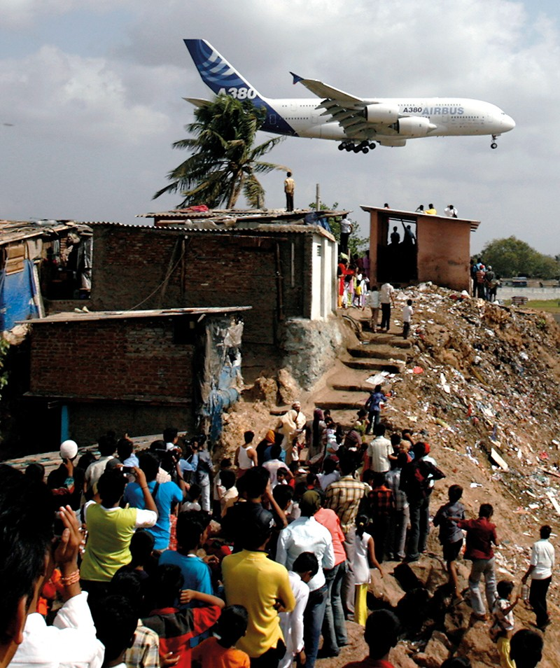 People watch plane land at Mumbai airport