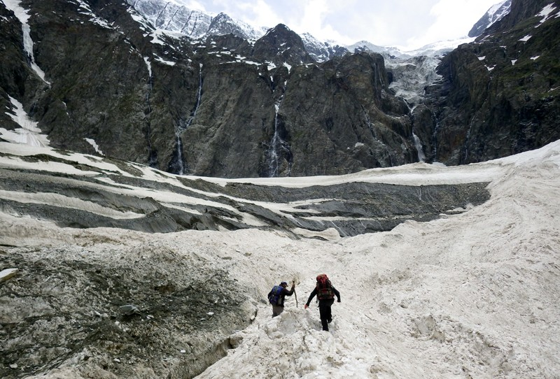 Researchers trek across a glacier