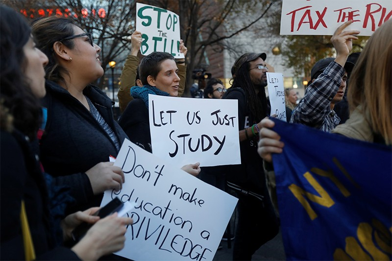 Students rally against the proposed GOP tax reform bill at Union Square, NY.