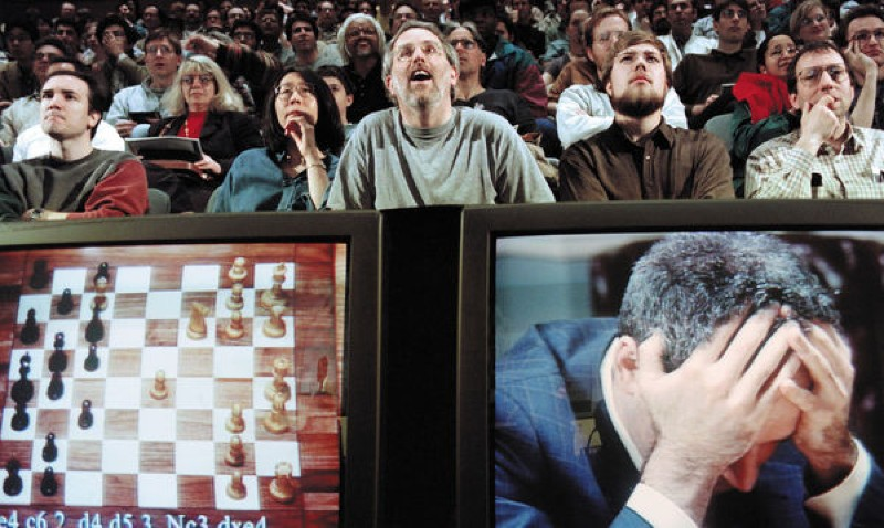 Chess grandmaster Garry Kasparov holds his head in his hands during his final game against computer program Deep Blue in 1997.