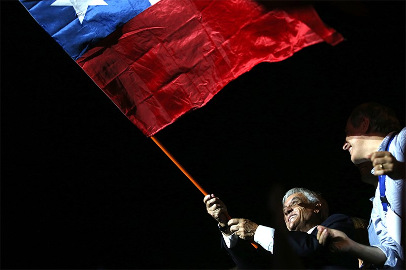 President elect Sebastian Pinera waves a Chilean flag on December 17th.
