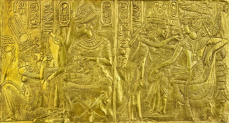 Detail from a gilded wooden shrine with scenes of Tutankhamen and Ankhesenamun.