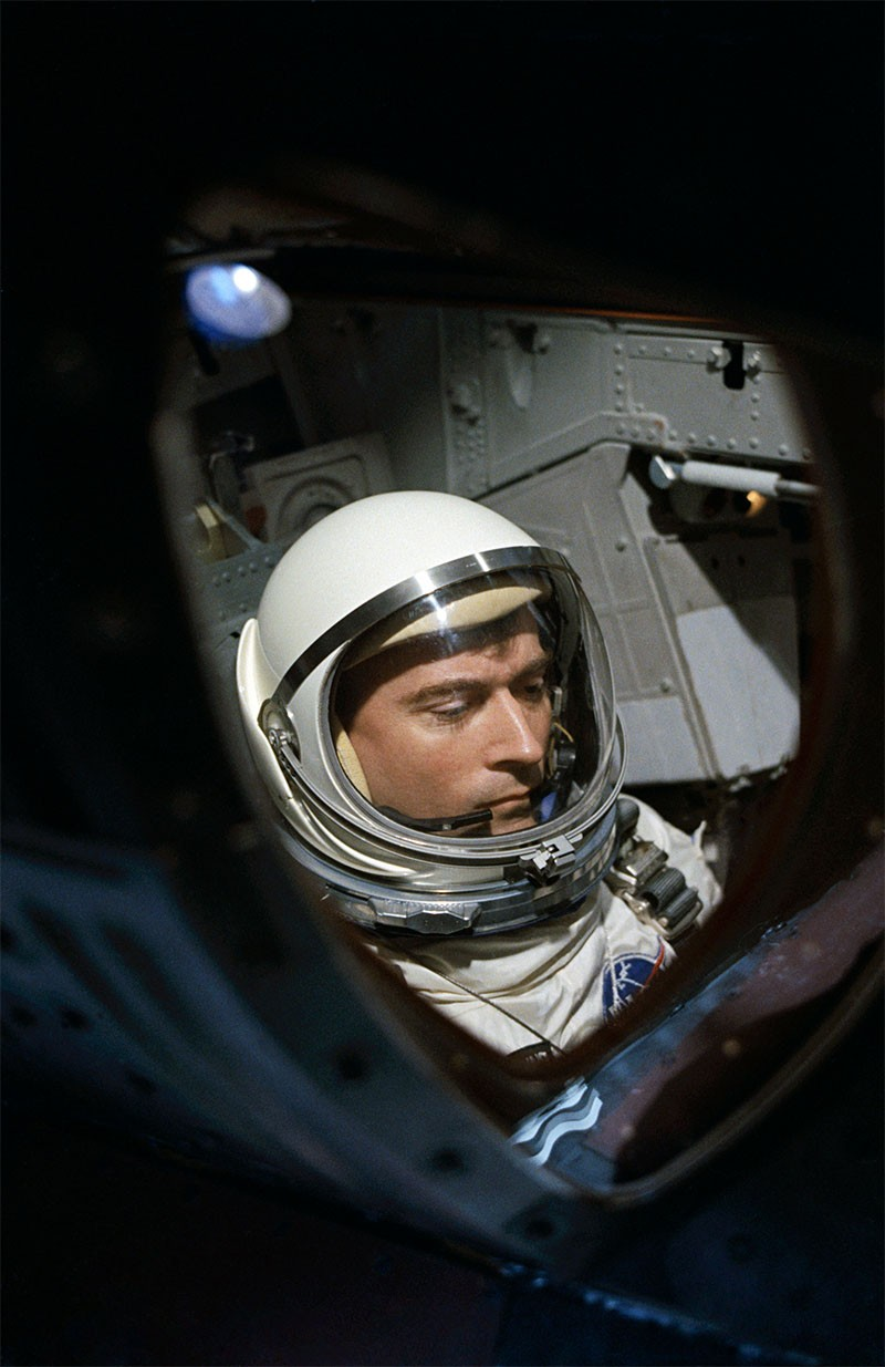 Astronaut John W. Young through spacecraft window