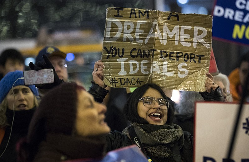 Protestors in New York City speaking against ending DACA