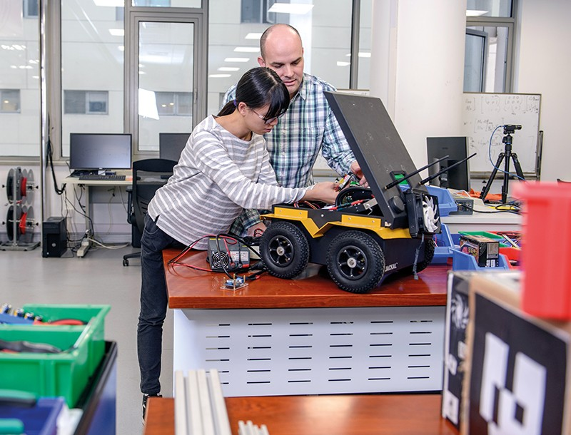Scientists working on a robot.