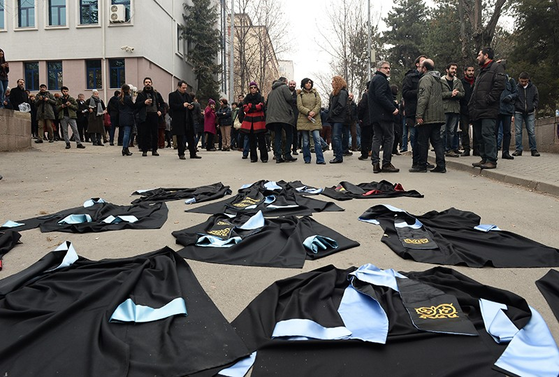 Academics lay down their gowns during a protest against the dismissal of academics in Turkey, 2017.