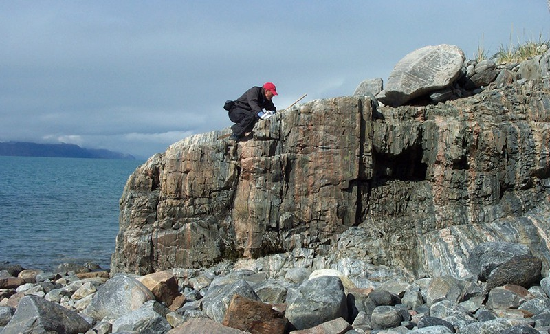 BIll Glassley examining rocks in Greenland